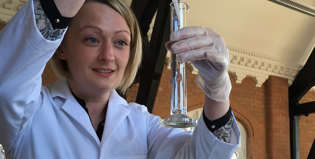 A woman holding a test tube