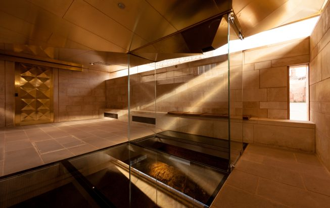 A room with stone and glass floor