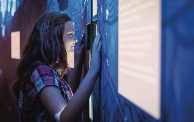 A girl looking at a wall