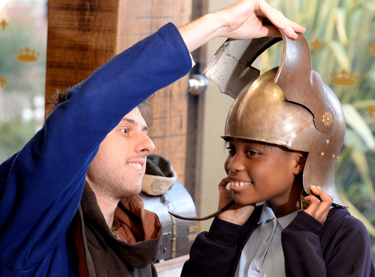 A girl with a helmet on, with a man