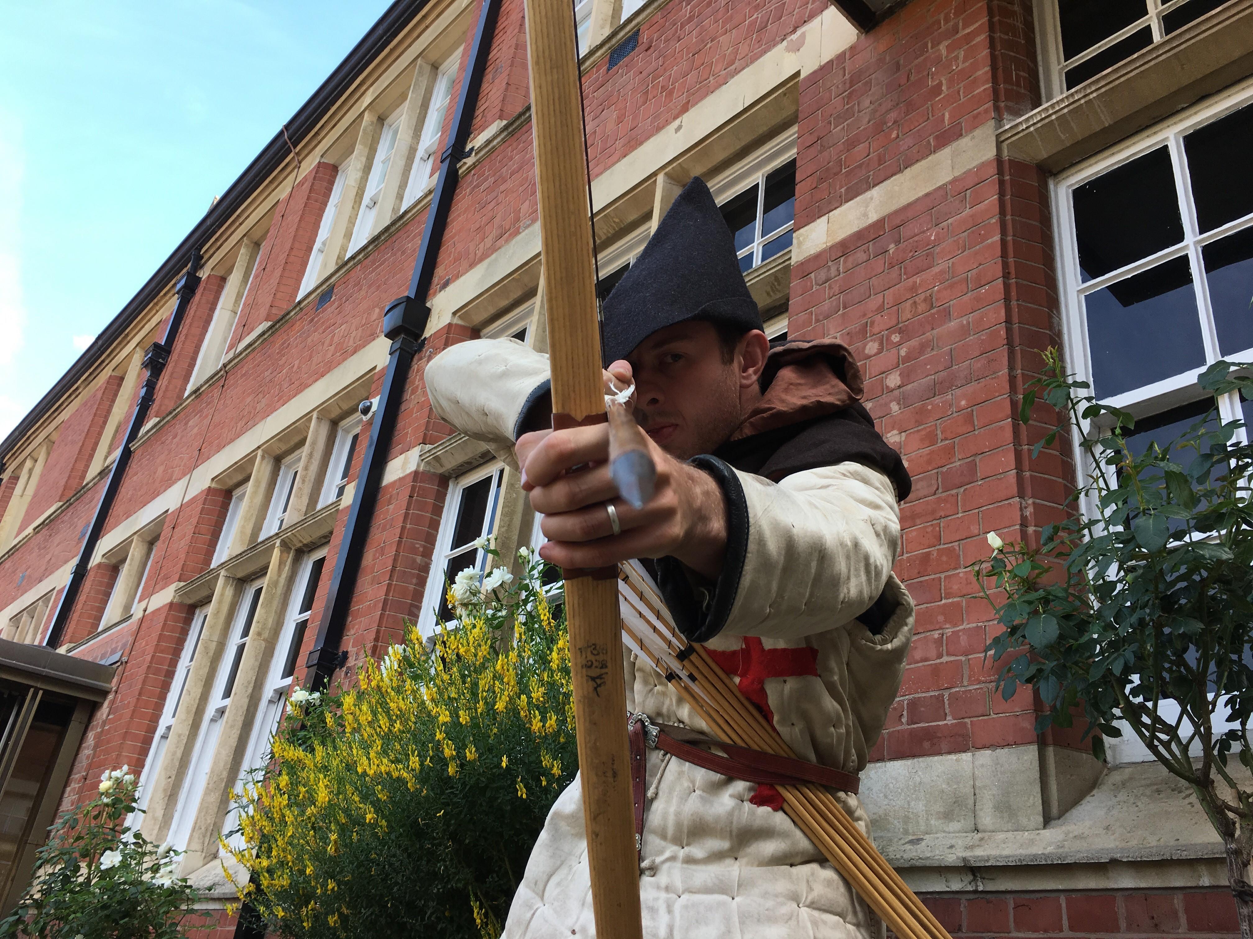 A man with a bow and arrow